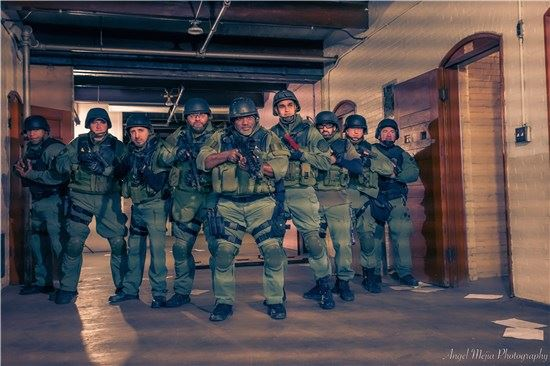 Image of nine special operations officers in gear